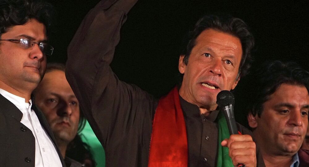 Pakistani politician Imran Khan addresses an anti-government rally near a parliament building in Islamabad, Pakistan, Tuesday, Oct. 21, 2014