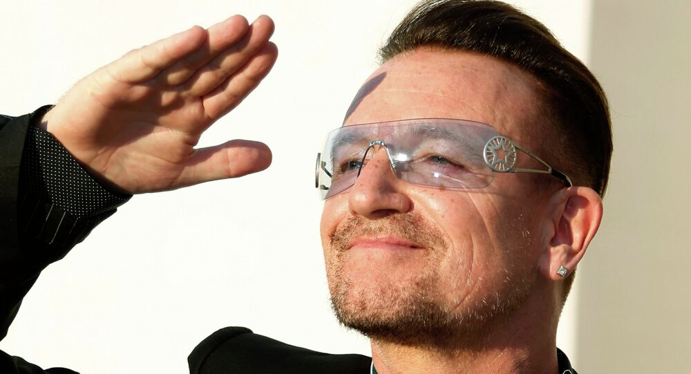 Bono, lead singer of the band U2, reacts after being awarded Commandeur des Arts et lettres (Commander in the Order of Arts and Letters) during a ceremony in Paris, in this file photo taken July 16, 2013