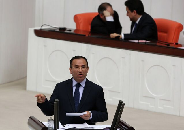 Justice Minister Bekir Bozdag speaks during a special session of the parliament in Ankara, Turkey, Wednesday, March 19, 2014