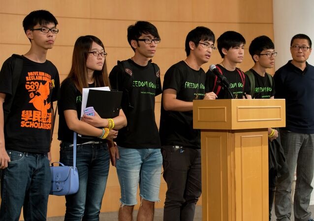 Student leader Alex Chow, center, speaks along with other leaders, during a news conference after the talks with the Hong Kong government officials, in Hong Kong Tuesday, Oct. 21, 2014