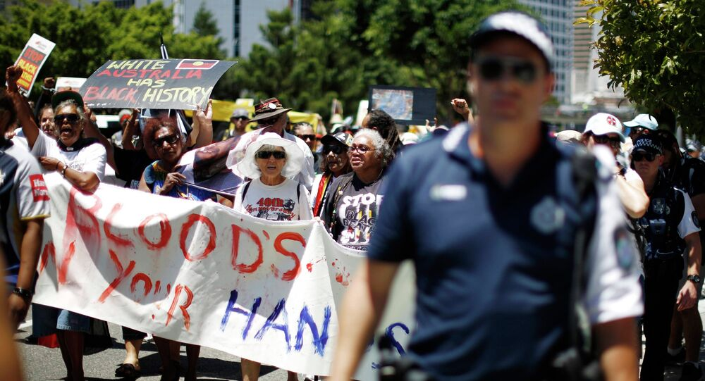 Protesters demanding human rights for Australia's Aboriginal community march near the venue of the annual G20 leaders summit in Brisbane, November 14, 2014