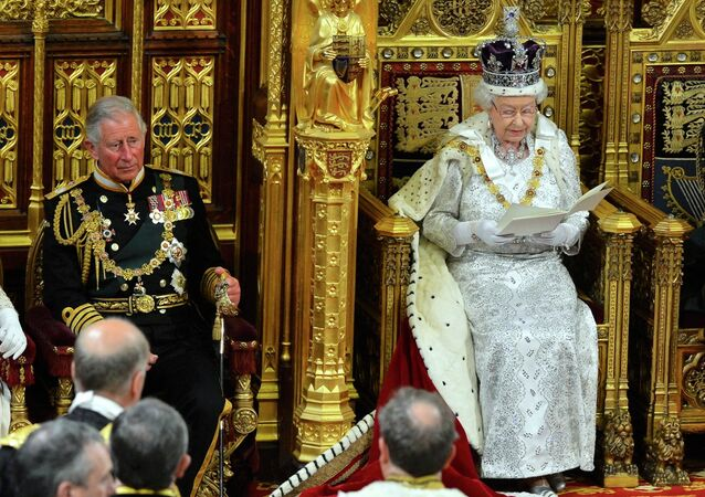 File photo of Britain's Queen Elizabeth as delivers her speech during the State Opening of Parliament at the House of Lords, alongside Prince Charles in London