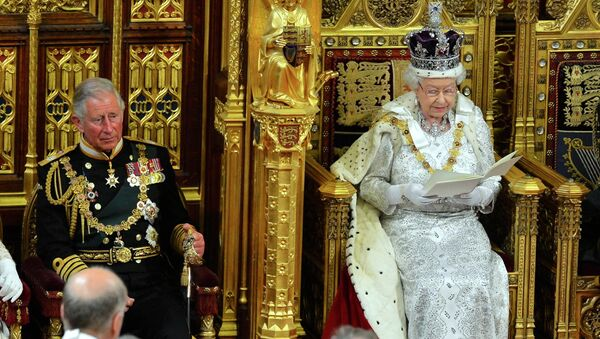 File photo of Britain's Queen Elizabeth as delivers her speech during the State Opening of Parliament at the House of Lords, alongside Prince Charles in London - Sputnik International