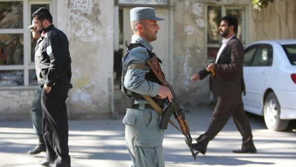 Afghan Police patrols near the site of a suicide attack in Kabul, Afghanistan, Sunday, Nov. 9, 2014 - Sputnik International