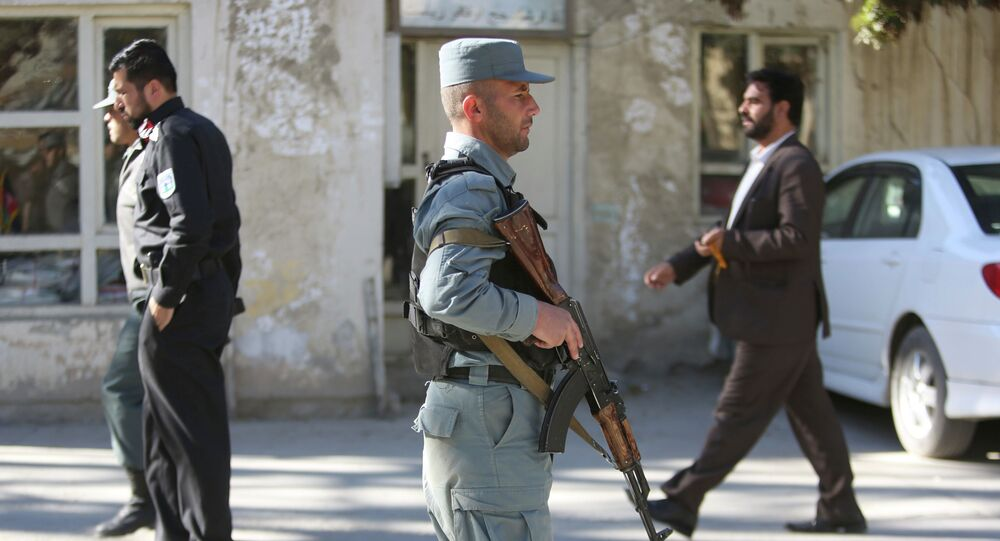 Afghan Police patrols near the site of a suicide attack in Kabul Afghanistan
