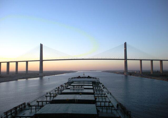 Capesize bulk carrier, approaches the Suez Canal Bridge