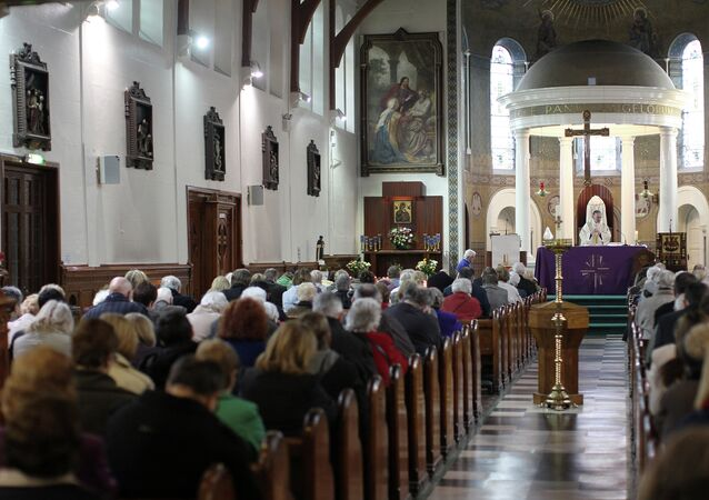 A priest takes mass at St Mary's Roman Catholic Church in Belfast, Northern Ireland. (File)
