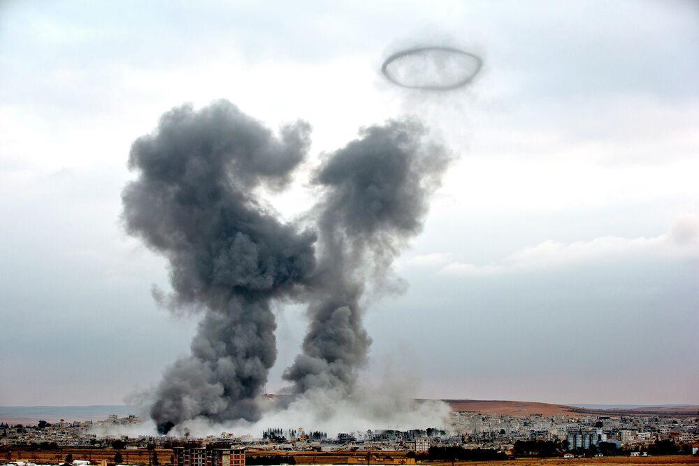 Smoke rises from the Syrian city of Kobani