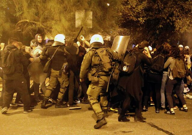 Riot policemen clash with protesters