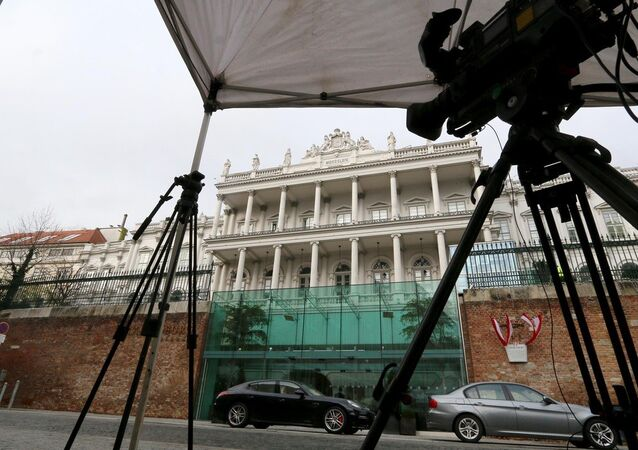 Cameras stand under a tent in front of Palais Coburg where closed-door nuclear talks with Iran take place in Vienna, Austria, Tuesday, Nov. 18, 2014