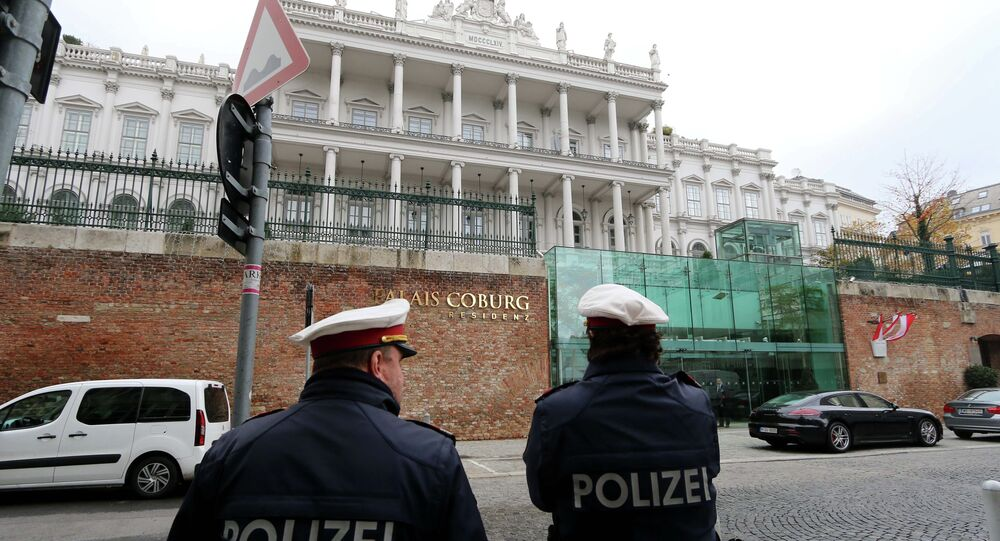 Police guard in front of Palais Coburg where closed-door nuclear talks with Iran take place in Vienna, Austria, Tuesday, Nov. 18, 2014