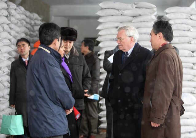 Former UN political chief B. Lynn Pascoe tours a food processing factory called The Pyongyang Children Foodstuff Factory where the World Food Program produces flour in Pyongyang
