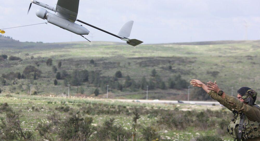 An Israeli soldier launches the Skylark drone during a drill near Bat Shlomo