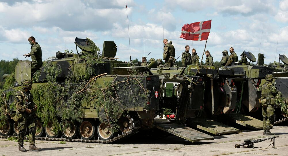 Danish soldiers during a military exercise ' Saber Strike 2014 ' at the Rukla military base some 120 km. (75 miles) west of the capital Vilnius, Lithuania, Tuesday, June 17, 2014