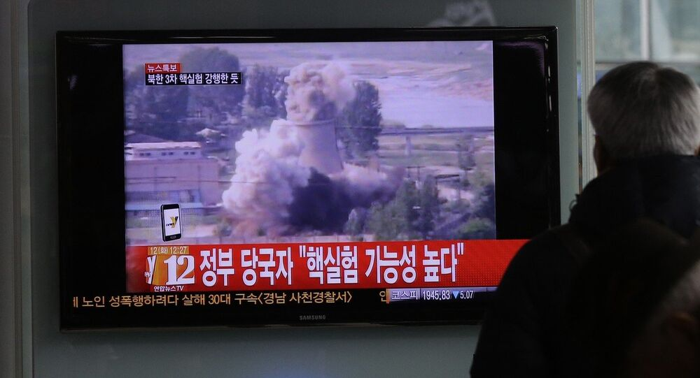 A South Korean man watches a TV news showing a file footage of North Korea's nuclear test at the Seoul train station in Seoul, South Korea