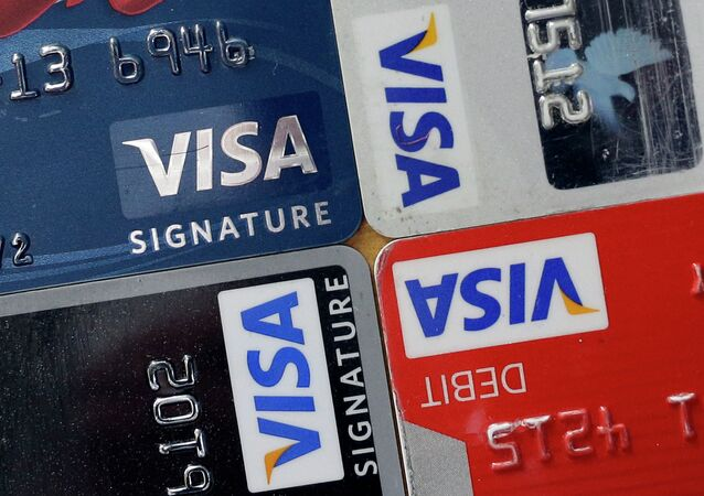 In this April 25, 2013 file photo, credit and debit cards are displayed for a photographer in Baltimore. Visa Inc. reports quarterly earnings on Thursday, April 24, 2014