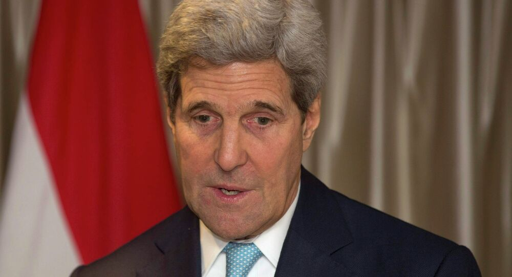 U.S. Secretary of State John Kerry reacts after meeting Egypt's Foreign Minister Sameh Shoukry in London November 18, 2014