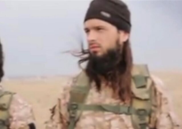 This still image taken from an undated video published on the Internet by the Islamic State group militants and made available, Sunday, Nov. 16, 2014 shows a militant that the French government say is Frenchman Maxime Hauchard