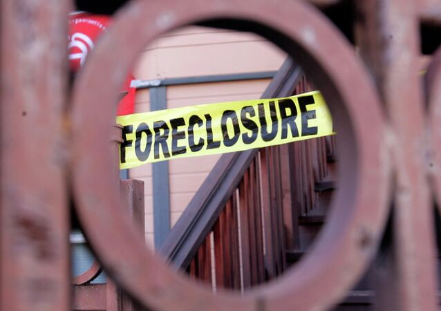 Foreclosure sign shown through a front gate of a foreclosed home in Oakland, California