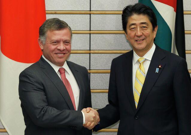 Jordanian King Abdullah II, left, and Japanese Prime Minister Shinzo Abe