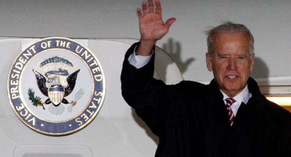 U.S. Vice President Joe Biden waves upon his arrival at Boryspil International airport outside Kiev November 20, 2014