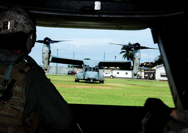 View from the rear ramp of a U.S. Marine Corps MV-22B Osprey before it takes off from Barclay Training Center in Monrovia, Liberia, Oct. 24.