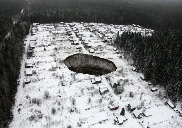 An aerial view shows a sinkhole 3.5 km (2 miles) to the east of Solikamsk-2 mine in Perm region, November 20, 2014
