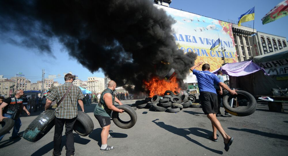 Protesters burn car tires on Independence Square (Maidan) in Kiev.