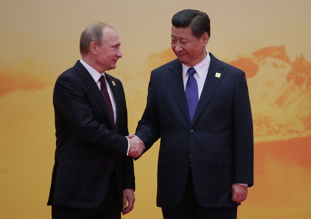 November 11, 2014. Russian President Vladimir Putin, left, and Chinese President Xi Jinping