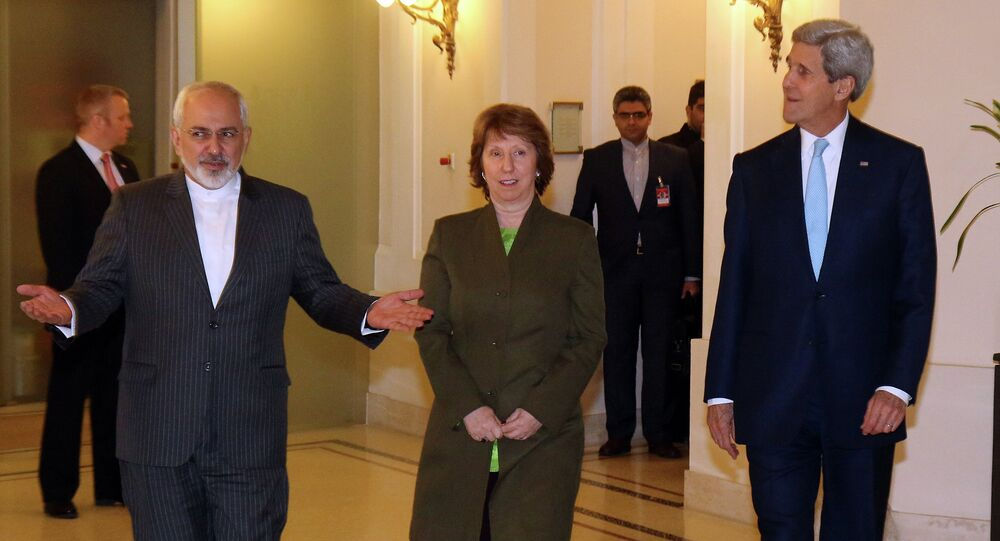 Iranian Foreign Minister Mohammad Javad Zarif, left, U.S. Secretary of State John Kerry, right, and former EU foreign policy chief Catherine Ashton