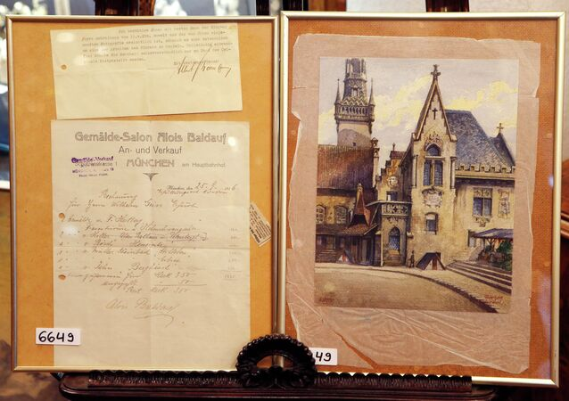 "A picture titled ""The Old City Hall"", right, that - as the auction house said - was painted by Adolf Hitler"