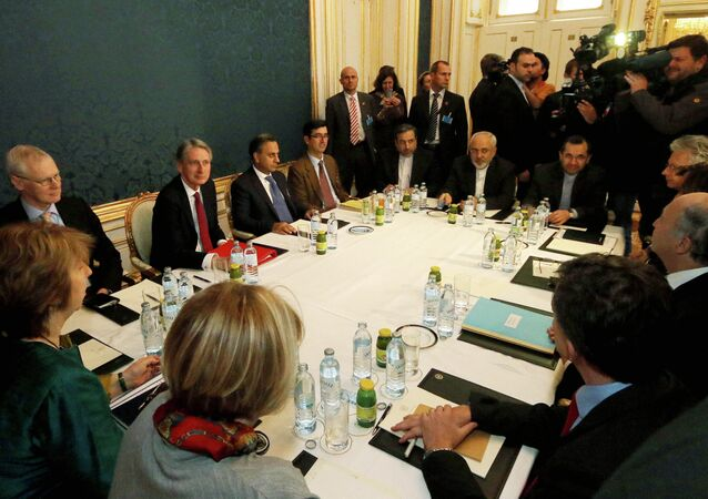 Former EU foreign policy chief Catherine Ashton, left, British Foreign Secretary Philip Hammond, third left, Iranian Foreign Minister Mohammad Javad Zarif, rear center, and French Foreign Minister Laurent Fabius, second right, wait for the start of closed-door nuclear talks with Iran.