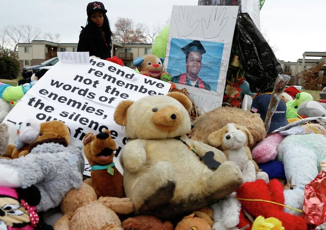 A woman stops to visit the memorial set up where Michael Brown was shot and killed in Ferguson, Missouri, November 22, 2014