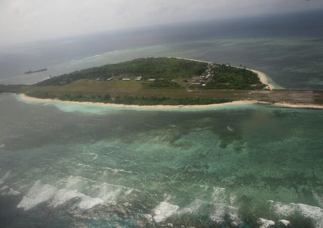 China has confirmed military installations on an artificial island near the disputed Spratly islands