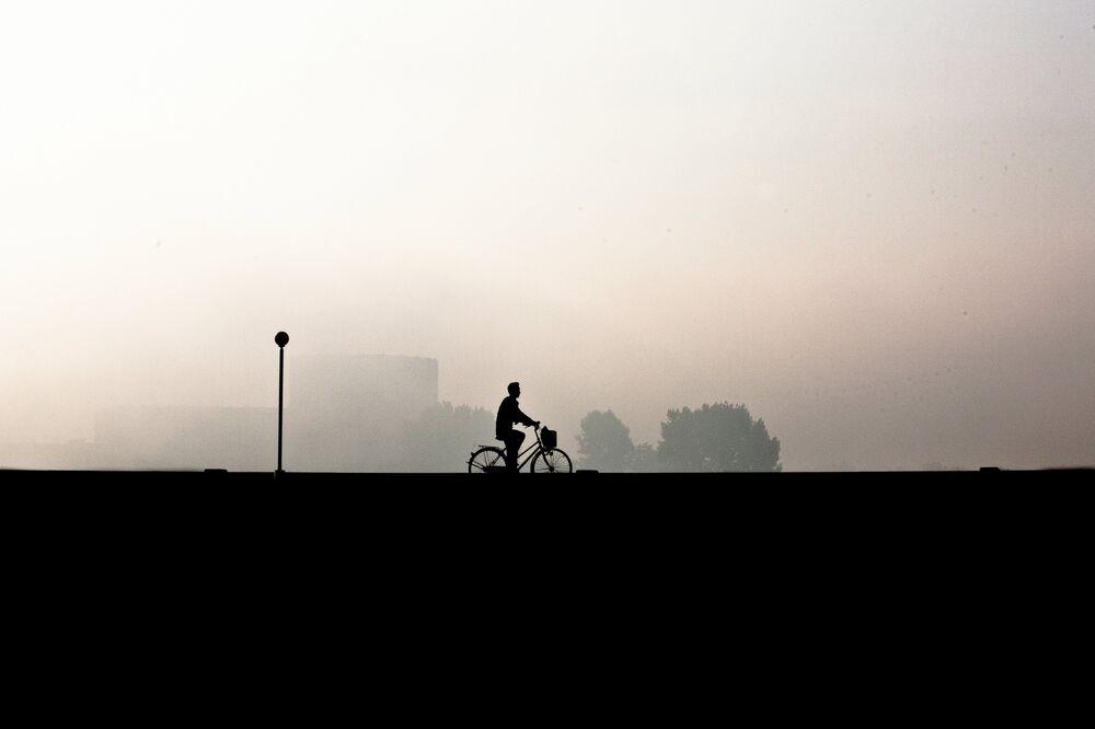 Cyclist in Pyongyang, North Korea