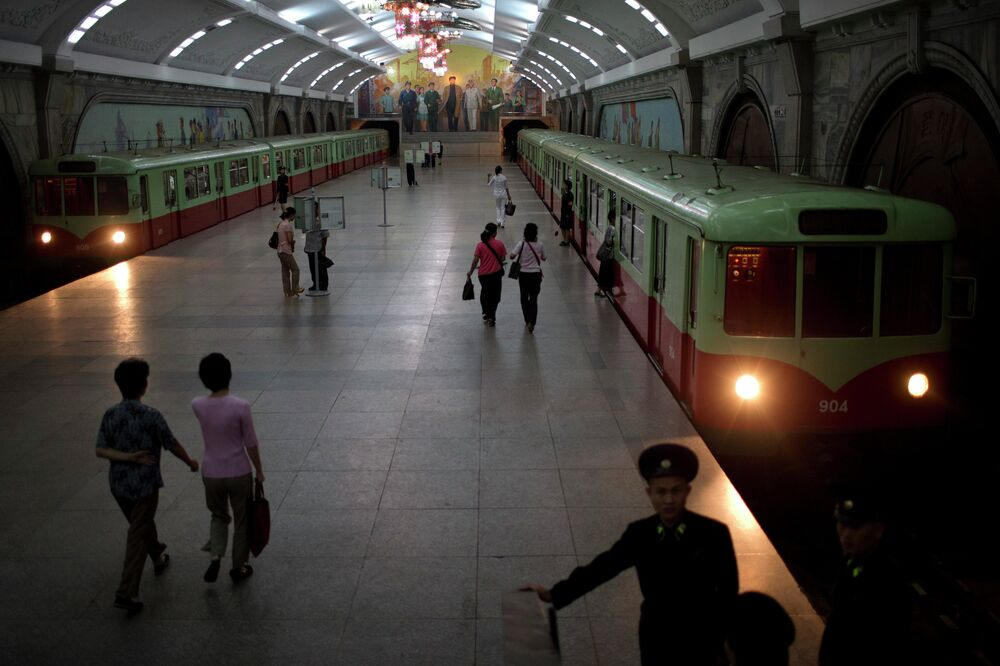 Commuters walk inside Puhung subway station, or prosperity station, in Pyongyang, North Korea