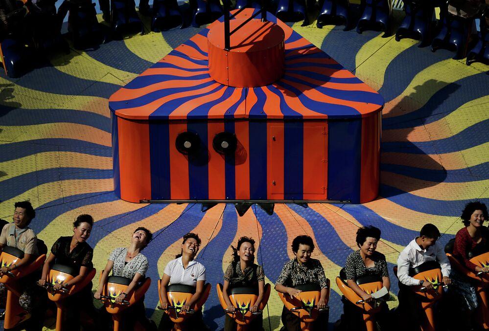 AP10ThingsToSee- North Koreans enjoy a ride at the Kaeson Youth Amusement Park