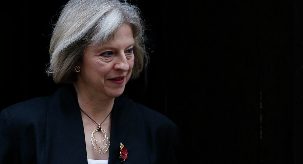 Britain's Home Secretary Theresa May leaves a cabinet meeting at 10 Downing Street in central London