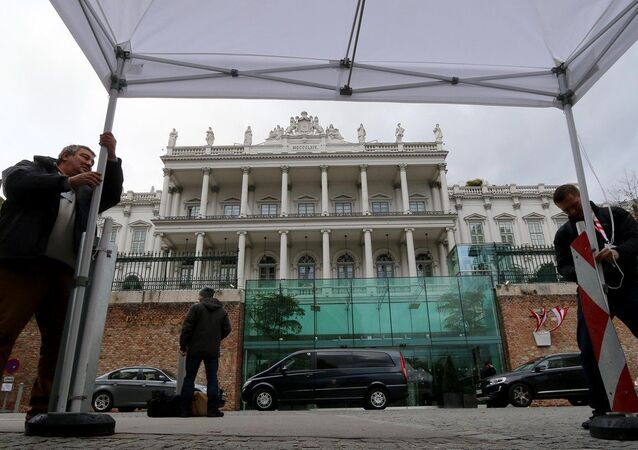 Journalists fix a tent in front of Palais Coburg where closed-door nuclear talks with Iran take place in Vienna, Austria, Wednesday, Nov. 19, 2014