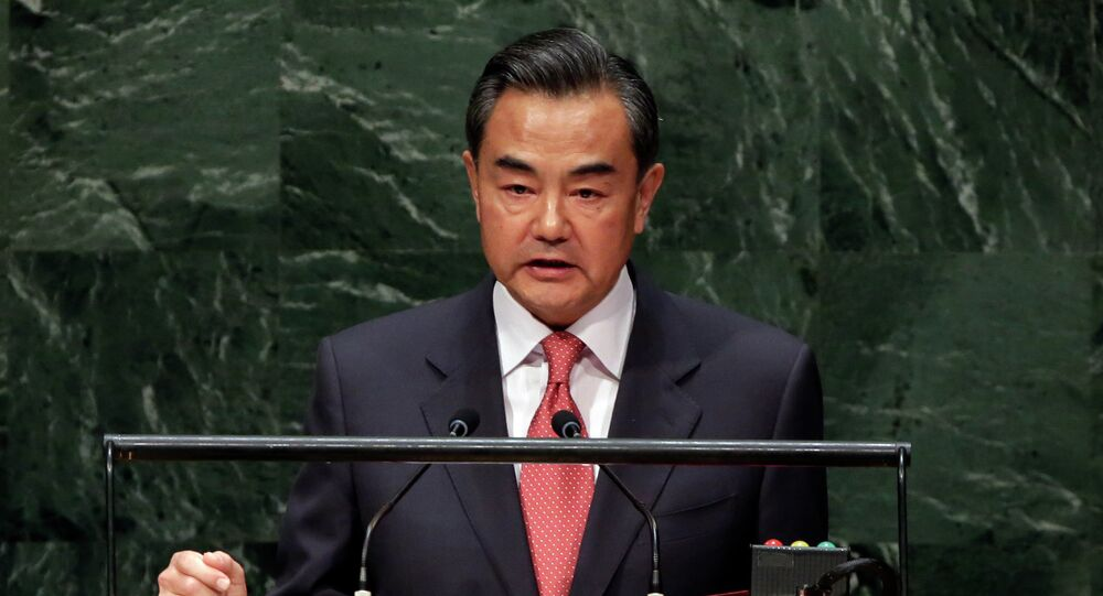 A light at the end of the tunnel is beginning to appear in ongoing talks over Iran's disputed nuclear program, Chinese Foreign Minister Wang Yi said at a press conference Sunday.
