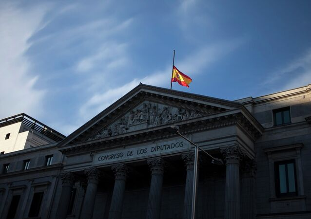A Spanish flag flies at half staff in memory of Spain's former Prime Minister Adolfo Suarez at the Parliament in Madrid, Spain
