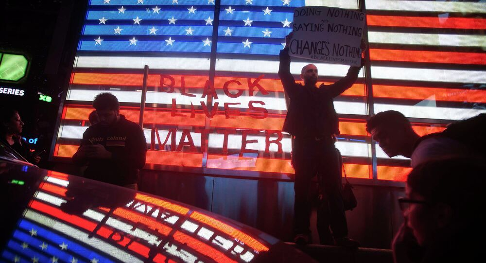 Protesters demonstrate in Times Square after the grand jury's decision to not charge Ferguson police officer Darren Wilson in the shooting death of unarmed 18-year-old Michael Brown was announced, in New York