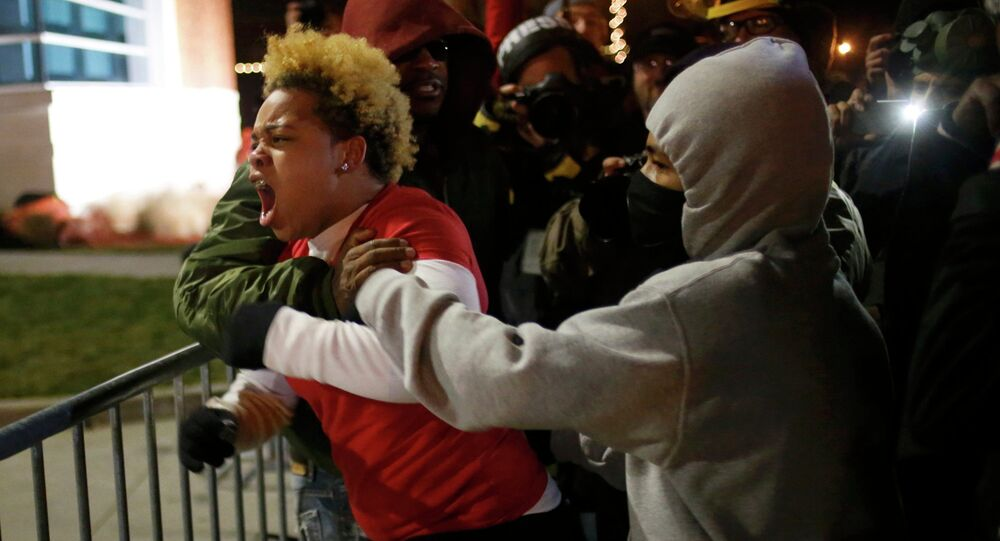 A woman approaches the barricade to confront the police outside the Ferguson Police Department in Ferguson, Missouri