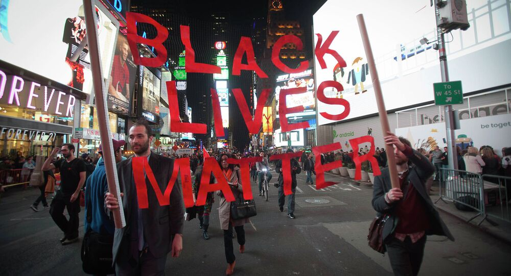 Protesters demonstrate in Times Square after the grand jury's decision to not indite Ferguson police officer Darren Wilson in the shooting death of unarmed 18-year-old Michael Brown was announced, in New York