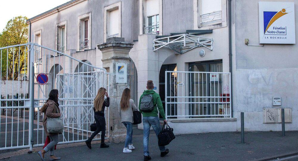 Students arrive at the Fenelon-Notre Dame high school in La Rochelle, western France