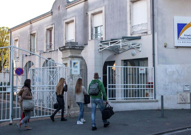 Students arrive at the Fenelon-Notre Dame high school in La Rochelle, western France