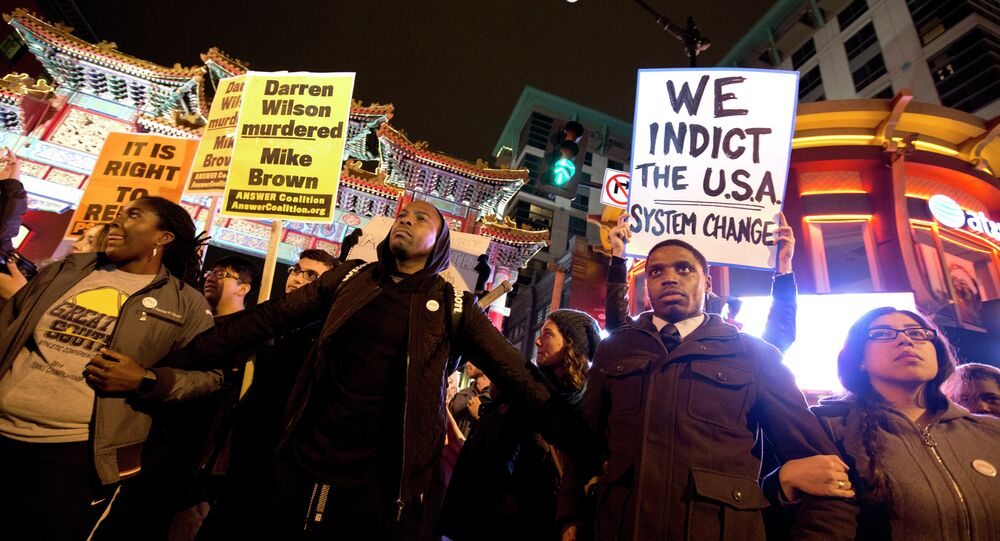 Protesters gather and link arms in the Chinatown area of Washington