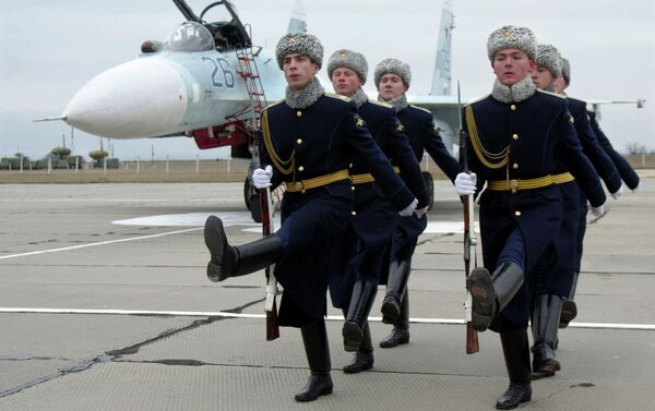 An official welcoming ceremony for the crews of Sukhoi Su-27 SM Flanker fighters, due to serve with the 62nd Fighter Regiment of the 27th Combined Air Division of the Russian Air Force at Belbek airfield near Sevastopol. - Sputnik International