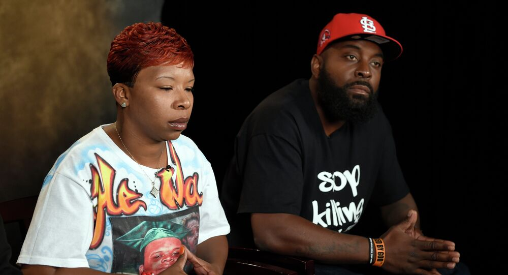 The parents of Michael Brown, Lesley McSpadden, left, and Michael Brown, Sr., right, take part in an interview with The Associated Press