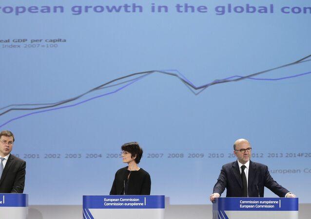 European Commissioners address the media at the European Commission headquarters in Brussels, Friday, Nov. 28, 2014